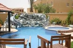 large swimming pools with waterfall and slide - Google Search