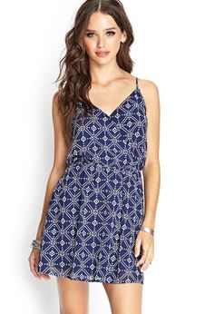 Style Deals - This chiffon surplice dress features an allover Southwestern print and adjustable s...