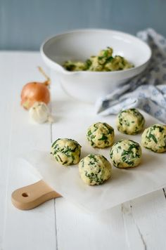Spinach Knödel with Gorgonzola Sauce... - 200g stale bread. 200ml milk 700g spinach 1 onion 2 cloves of garlic 2 eggs 50g grated alpine cheese 50g ricotta 100g flour Nutmeg, salt and pepper Cut the bread into cubes, place in a large bowl, add the milk and let stand. Finely chop onion, garlic -sauté & add spinach. drain in sieve. Mix with cheese, flour, eggs, salt, nutmeg & pepp. Let rest for 15 minutes. Boil small dumplings -15-20 min. Fry onion in the pan. Add cheese cubes & cream.