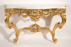Louis XV style carved wood console with antiqued goldleaf finish and Calacotta gold marble top.