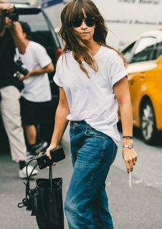 Miroslava Duma showing off the perfect way to style classic jeans. // The Best Street Style Inspiration From New York Fashion Week: (http://www.racked.com/2015/9/11/9309889/nyfw-street-style#4834070)