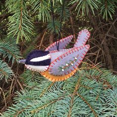 4 1/2 L X 2 1/4 T X 1 1/4 W. This three dimensional red breasted nuthatch ornament is made from wool felt and decorated with embroidery.
