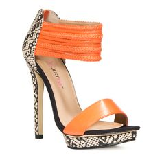 Pin to win $500.00. The stiletto refined, redesigned and now is this shoe's time to shine!  The orange straps are touches of high couture, and the color pairs spectacularly with the neutrals of the snake skin look!  I am ordering mine today!