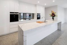 White gloss cabinets, marble island bench, smoked mirror splashback and polished. White gloss cabinets, marble island bench, smoked mirror splashback and polished concrete flooring - all add up to a big wow factor! White Gloss Kitchen, White Marble Kitchen, Polished Concrete Kitchen, Mirror Splashback, Splashback Ideas, Kitchen Island Bench, Kitchen Islands, Marble Island, Küchen Design