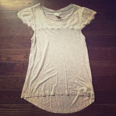 Cream and grey lace tee This is an ultra soft tee shirt with lace detail making it more interesting than your typical grey tee! Anthropologie Tops Tees - Short Sleeve