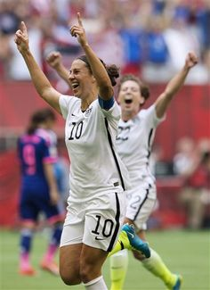 United States' Carli Lloyd (10) and Meghan Klingenberg (22) celebrate Lloyd's third goal against Japan during first half action in the FIFA Women's World Cup soccer championship in Vancouver, British Columbia, Canada, Sunday, July 5, 2015. (Jonathan Hayward/The Canadian Press via AP) MANDATORY CREDIT ▼6Jul2015AP Lloyd hat trick leads US over Japan 5-2 for World Cup title http://bigstory.ap.org/article/6a0b18ca45fd43df960be78a1f6e036a #2015_FIFA_Womens_World_Cup #Final_United_States_vs_Japan