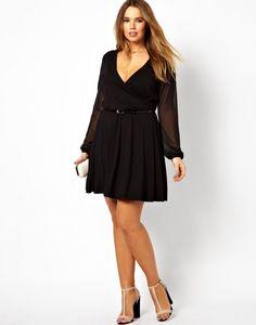 (Foto 23 de 25) Traje corto en color negro, con manga larga y cintura ceñida, Galeria de fotos de 25 vestidos cortos para mujeres un poco más gorditas