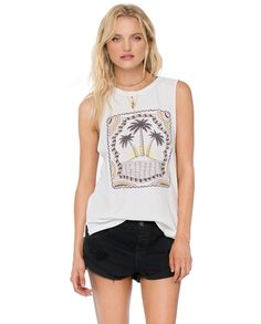 """The Tres Palms Tank is an oversized premium jersey muscle tank with raw cut armhole and a slight shirt tail hem. Novelty palm design printed at center front.Made with 100% Cotton.Measurements from a size Small: Bust 35"""" Front Length 26 1/4"""" Back Length 27 5/8""""Model is wearing a size Small."""