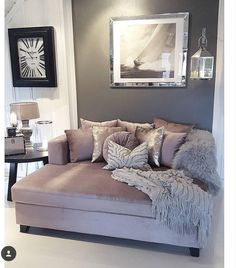 comfy loveseat with plush pillows and blankets