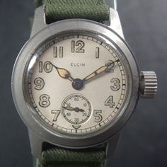 """During WWII there were many manufacturers of """"Military"""" watches. Elgin, Bulova Hamilton to name a few. This is an Elgin. I love the looks of these watches. If I had the means I would probably have a collection!"""
