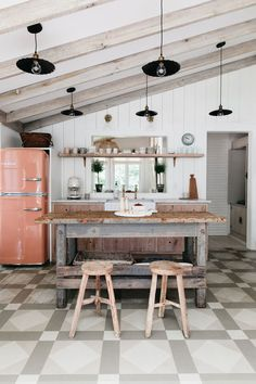Electic kitchen with patterned floor and rustic kitchen island