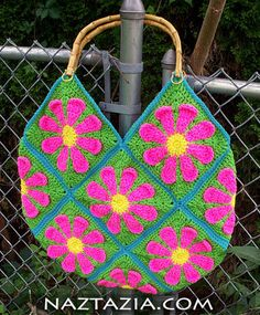 Crochet flower purse.  Pattern is just the granny square but it looks like it would b easy to put them together a d add some handles--line it of course..