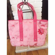 Coach Signature C Bag 100% Authentic Coach Shoulder bag. Pink with pink trim, signature C's.  Long strap included.  In very good condition.  Pre-owned but only used while on one vacation.  Inside is almost spotless with few minor marks.  Outside is in great condition! Coach Bags Shoulder Bags