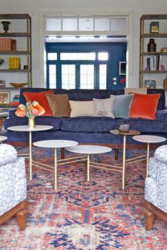 Traditional rug is amped up with a mid-century style coffee table and current fabrics. Taylor Jacobson Interior Design
