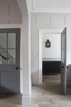 Light grey walls with grey doors and white trim. Grey Interior Design, Interior Design Kitchen, Classic Interior, Design Interiors, Wood Wainscoting, Wood Paneling, Paneling Ideas, Wall Panelling, Wood Walls