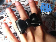 ring big black bow made of polymer clay, adjustable ring.