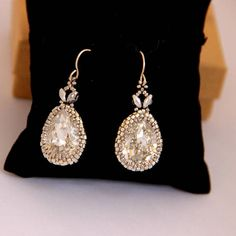 Swarovski 18*13 with silver seed beads. All the earring is 35 mm - 1.4 inches Silver Earring Ear Wire Hook silicon earring back are attached. Your order will be packed in a pretty gift box, as shown in last image. want to see more earrings? https://www.etsy.com/shop/Ranitit?section_id=14613553&ref=shopsection_leftnav_2# Want to see more items from this shop? click http://www.etsy.com/shop/ranitit