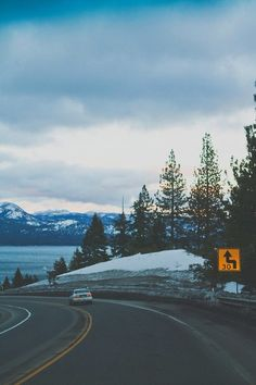 Dream Road   snow   mountains   winter   Road   Road Trip   Road Photo   Landscape photography   scenic   Drive   travel   wanderlust   on the road   empty road   Schomp BMW