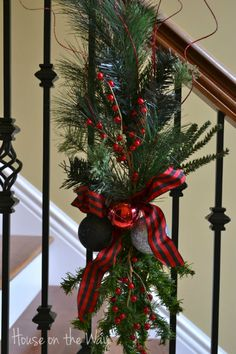 I made a change to my Christmas staircase decor this year! I'm using DIY swags instead of traditional Christmas garland. Christmas Stairs Decorations, Christmas Swags, Noel Christmas, Rustic Christmas, Winter Christmas, Christmas Crafts, Christmas Ideas, Thanksgiving Holiday, Primitive Christmas