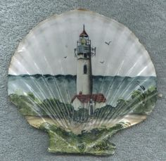 Sandy Knodel  artwork - seashell with yaquina lighthouse painted on it