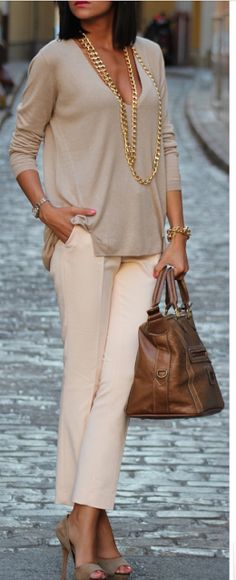 Although this top isn't structured it still fits well. The neckline makes it much more flattering and classy. Love the pants.