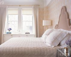 The master bedroom's mohair-velvet headboard is custom made, the bedcover is by Yves Delorme, and the pillow shams are by Pratesi; the walls are papered in Banana Leaf by Stark Wallcovering, and the curtains are made of Sinclair Shimmer by Ralph Lauren Home. - ELLEDecor.com