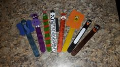 Zoo animals made with large popcicle sticks & foam sheets...elephant, hippo, snake, zebra, tiger, lion, penguin & bear (made for Girl Scout swaps)
