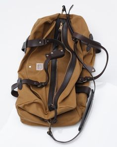"FILSON Duffle, Made in the USA. The ""must have"" companion on the road."