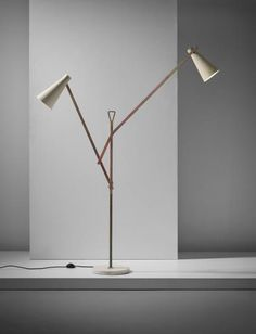 FRANCO BUZZI Adjustable standard lamp, circa 1958 Painted aluminium, tubular brass, brass, marble. 184 cm (72 1/2 in.) high fully extended Manufactured by O-Luce, Milan, Italy.