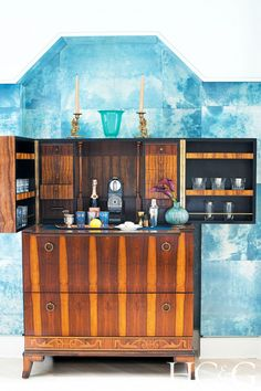 Tiled home bar with blue hues and dark wood cabinetry