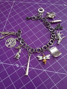 I love that they included the bat. https://www.etsy.com/listing/195958942/teen-wolf-inspired-charm-bracelet