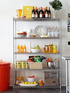 Apartment Decorating Ideas to Steal Right Now Employ an industrial metal shelving unit as extra kitchen storage if your apartment's kitchen storage options are less than generous Small Apartment Decorating, Home Kitchens, Extra Kitchen Storage, Home Decor, Pantry Design, Apartment Decor, Kitchen Storage, Metal Shelving Units, Apartment Kitchen