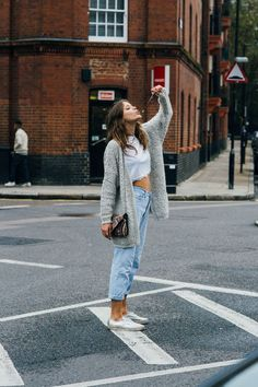 Grey cardigan, cropped white top, high waist jeans