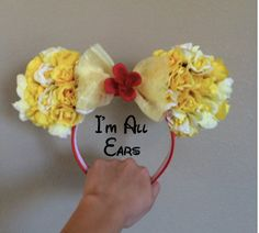 These HANDMADE Beauty and the Beast Inspired Mouse ears are perfect for your magical trip to theme parks, conventions, and more! This accessory will bring out your inner Princess Belle! These mouse ears are made to fit and be worn by all ages. Price: $35.20