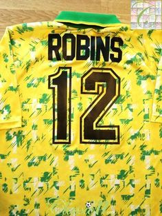 Official Ribero Norwich City home football shirt from the season. Complete with Robins on the back of the shirt in official lettering. Norwich City Football, Premier League Goals, Football Memorabilia, Serious Injury, Vintage Football, Robins, Football Shirts, How To Memorize Things, Lettering