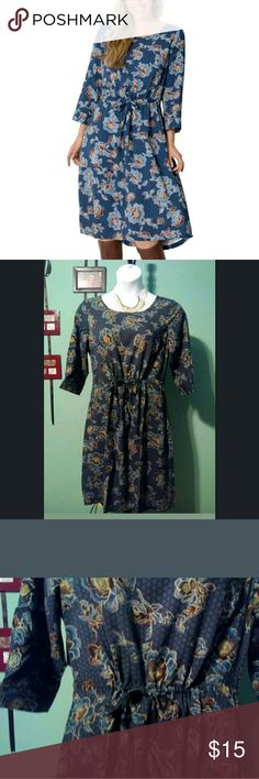 """Teal & Brown Floral Print Drawstring Waist Hi-Low Teal & Brown Floral Print Drawstring Waist Hi-Low Dress (14w)  Very lightweight hi low hem drawstring waist dress. Button sleeves. Back keyhole button closure.  Side pockets. Greatmulti-functionalpiece. Can be worn as a dress, tunic with skinny jeans & heels, swimsuit cover. Definitely Cruise or beach wear. Great for warm climate locations.  Length: waist to hem 24"""" front 26"""" back. Waist: fully extended 21.5 Bust: 21"""" across the front…"""