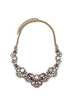 A statement necklace featuring a scalloped design, faux gems, rhinestones, a burnished chain, and a lobster clasp closure.