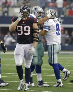 Romo, Bryant carry Cowboys past Texans 20-17 in OT - Houston Texans' J.J. Watt (99) walks away as Dallas Cowboys tackle Doug Free, left rear, celebrates a touchdown pass to Terrance Williams by quarterback Tony Romo (9) during the second half of an NFL football game, Sunday, Oct. 5, 2014, in Arlington, Texas. (AP Photo/Tim Sharp)