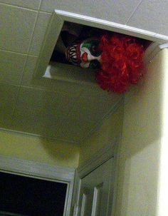 I put a wig foam head with a clown costume face and hair and put on top of our outdoor cooler to appear to be looking in