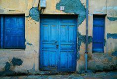 tattered doors in Spanish village by CuriosityTravels, via Flickr