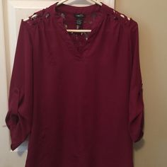 Red shirt/tunic (rue 21) size small It's been gently worn but is in very good condition! It has lace like details on the shoulders and buttons on sleeves. Size small but I usually wear a medium and it fit me great. Rue 21 Tops Blouses