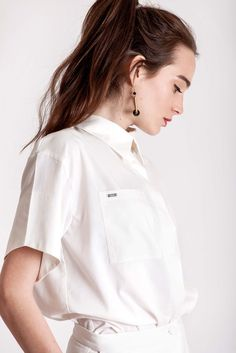 The fabric Cotton Style Hidden buck in front Coated buttons This white cotton blouse is perfect in combination with Dott. white pants or maybe as a twist to your jeans. White Cotton Blouse, Cotton Blouses, Cotton Style, White Pants, Piece Of Clothing, Slow Fashion, Chef Jackets, Feminine, Spring Summer