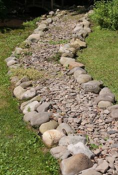 For down the side of the house....Stones & pebbles to create dry stream effect in garden pathway