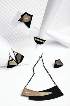 "Jewelry collection ""Golden rule"" by Rename.   Laser cut black and gold perspex jewelry"