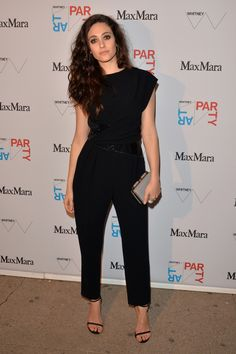 2ba0c6f89c54 Emmy Rossum attended the Whitney Art Party looking trendy in a black  jumpsuit with crisscross waist