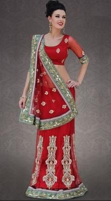 Magnificient Red Embroidered Saree  This Eye-Catching & Elegant Drape Is Perfect For Any Occasion. Add Grace And Charm To Your Appearance In This Beautiful Red Faux Georgette & Net Saree. Beautified With Bead, Embroidery With Stones/Crystals & Stones Work All Synchronized Well With The Pattern And Design Of The Attire. Comes with a matching stitched round neck blouse with 6 inches sleeves. #LatestLehegaSariIndia #BestIndianWomenSaree