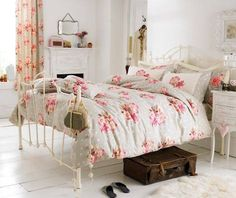 shabby chic bedroom with refurnished bedframe and floral bedspread
