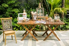 Tropical Destination Wedding Registration Table with Green Back Drop