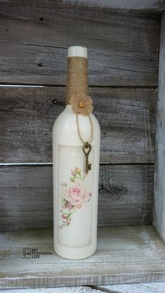 Repurpose some old wine bottles with some paint and an image transfer using Heirloom Traditions 1gel. Great gift idea for the wine lover in your family. Can be used as decor or a bud vase.