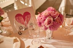 Reception Decor:  Table arrangement of pink Roses, Dahlias, Upright Amaranthus in silver julep vase.  By Heather Murdock of The Blue Orchid (image by Dorothy Hatchel Photography)